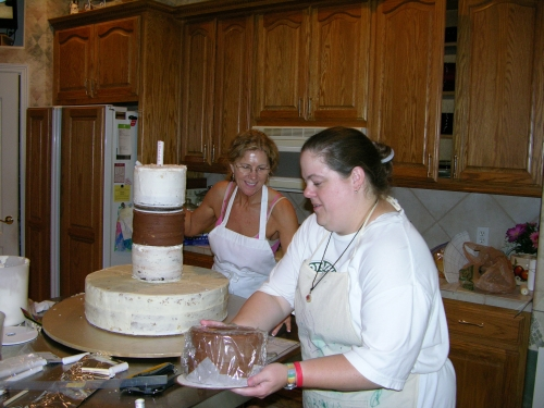 Chris and Kim working on the DoS cake