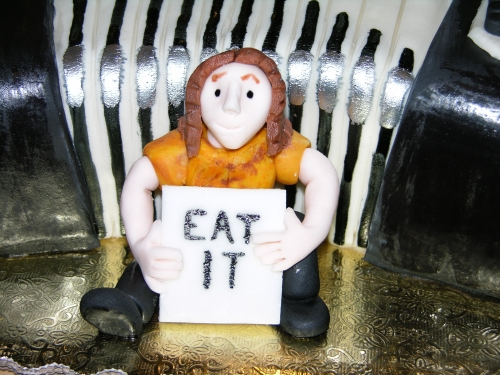 Detail of the Weird Al figure on the accordion cake.
