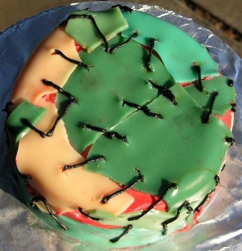 Gummy zombie skin cake top.