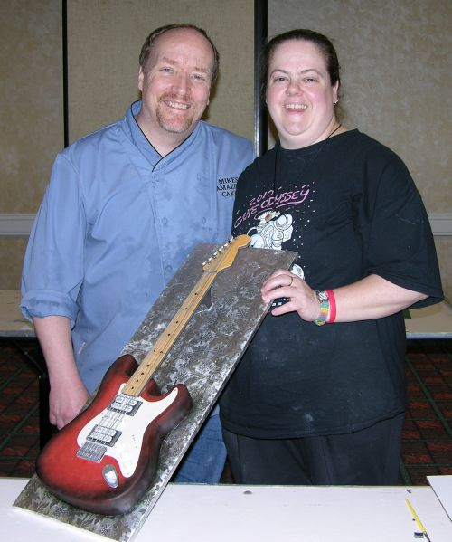 Mike McCarey with me holding up the guitar cake