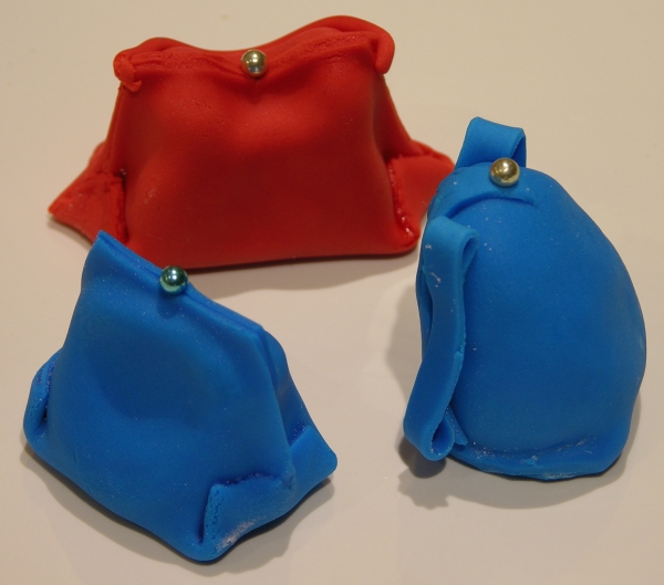 three cake ball purses