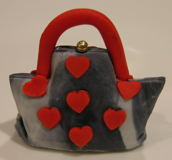 red hearts on grey marble purse