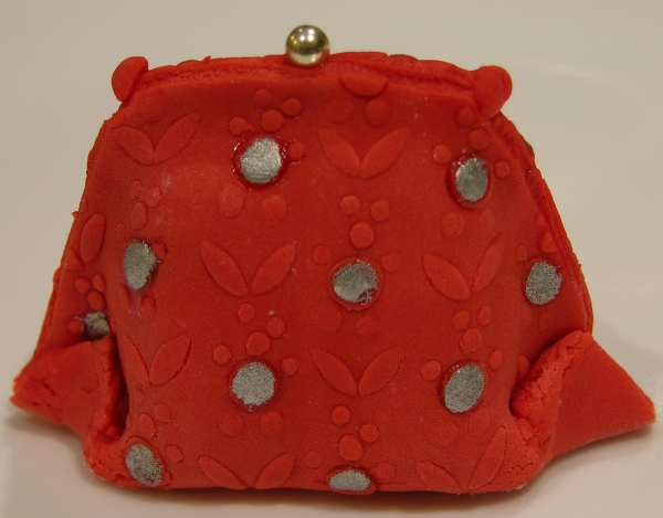red flower purse with silver paint