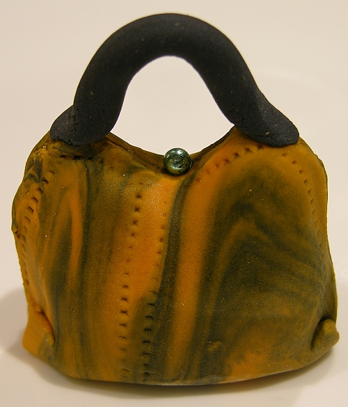 black and orange marbled purse