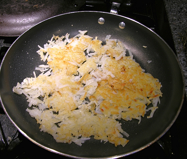 hash browns in a frying pan