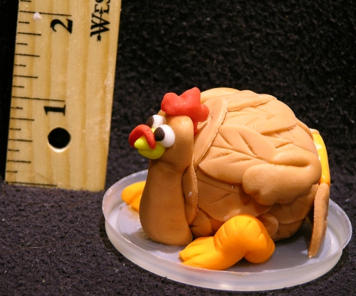 mini turkey cake ball with ruler
