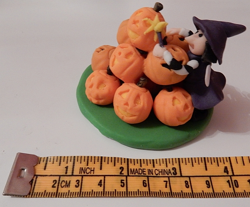 Pumpkin pile and Halloween fairy in less than 4 inches