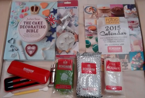 books, pens, fondant, marzipan, and cake decorating tools