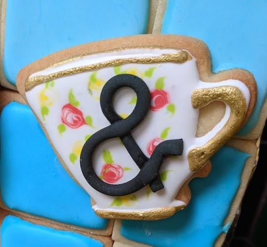 tea cup ampersand