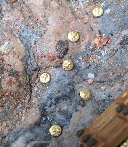 tiny gold coins on sugar rock