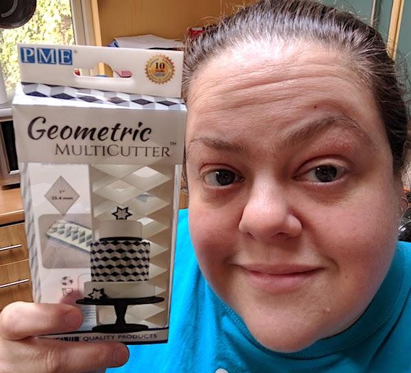 me holding a PME Geometric Multicutter